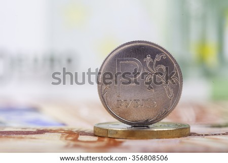 coin ruble on the background of banknotes - stock photo
