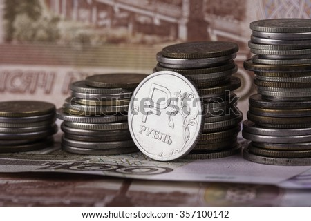 coin ruble on the background of banknotes and money stacks - stock photo