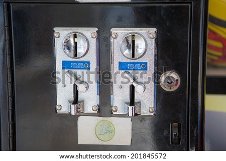 Coin slots of old gaming machine - stock photo