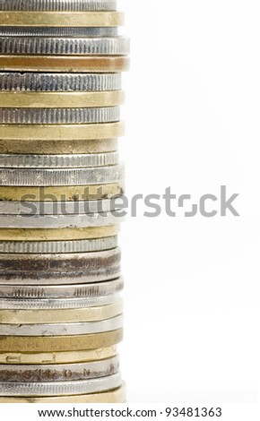 Coin stack, close-up on white background - stock photo