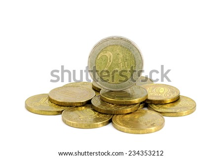 Coin two euros on a pile of ten-worth of coins - stock photo