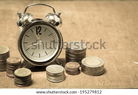 Coin with time investment concept - stock photo