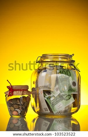 Coins and banknote in money jar on yellow background - stock photo