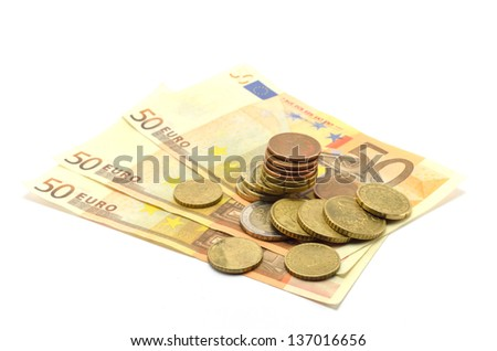 coins and banknotes euro on a white background - stock photo