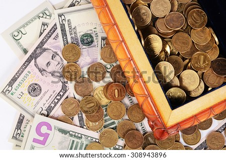 Coins and banknotes in the box close-up
