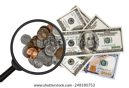 coins and banknotes under a magnifying glass  isolated on white background - stock photo