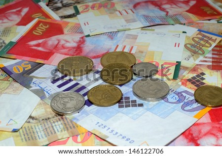 Coins and bills 50, 100, 200 shekel - stock photo
