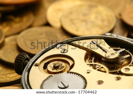 coins and clock - stock photo