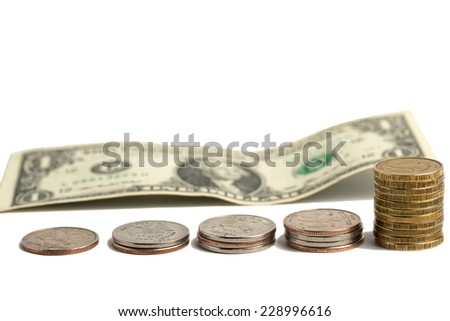 Coins and dollar bills. The growth of the dollar - stock photo