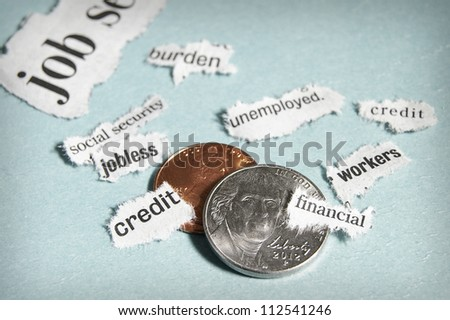 coins and mini current events newspaper headlines - stock photo