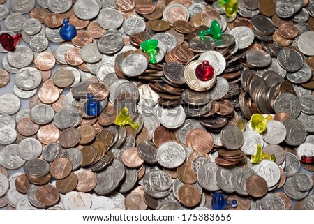 Coins and pawns illustrating success and failure - stock photo