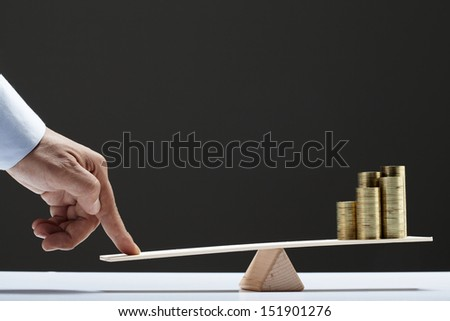 coins balance on wooden board - stock photo