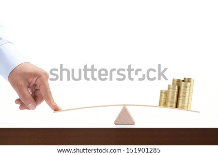 coins balance on wooden board