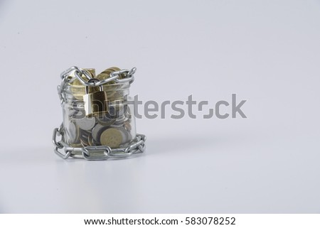 Coins chained isolated on white. Saving and security concept.