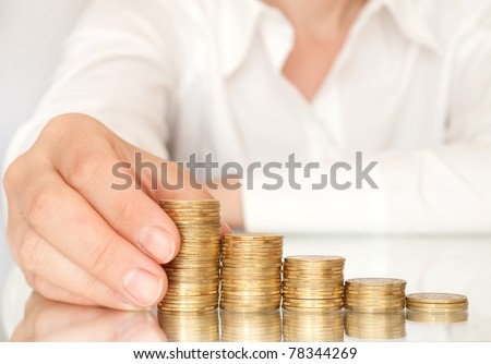 coins diagram and hand with reflection - stock photo