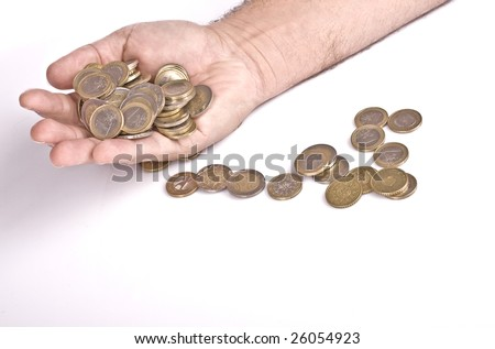 Coins falling from a male?s hand