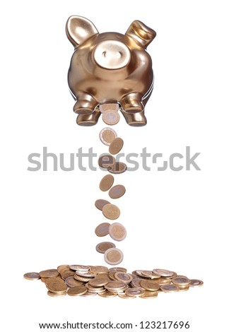 coins falling out of golden piggybank