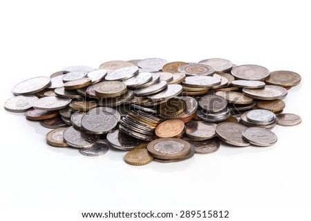Coins from different countries on white background