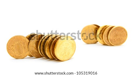 Coins from gold. On a white background.