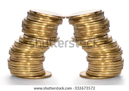 Coins from yellow metal isolated on a white background - stock photo
