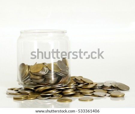 Coins in a glass jar. Saving money for you