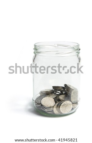 Coins in Glass Jar on White Background