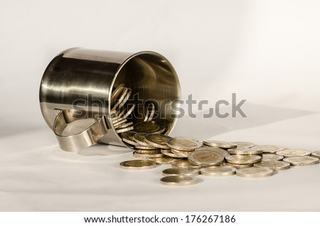 coins in glass on white background