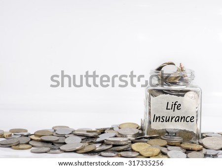 coins in jar with life insurance label in isolated white background; financial concept - stock photo