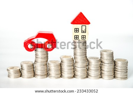 coins in pile and house and car isolated image - stock photo