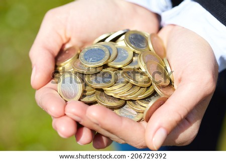 coins in the hand - stock photo