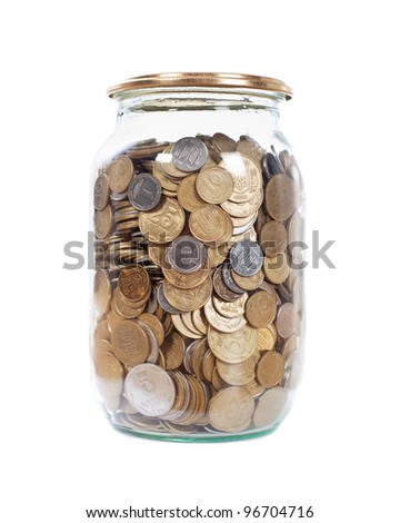 Coins in the jar on white background