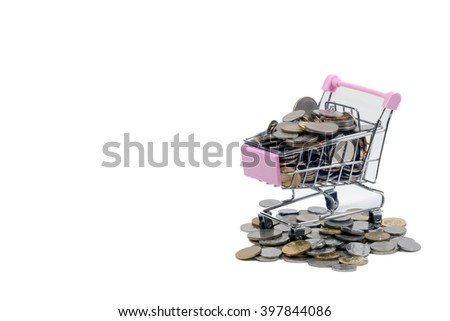 Coins inside mini trolley - stock photo
