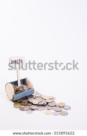 Coins money on white background from small wallet with three wording house