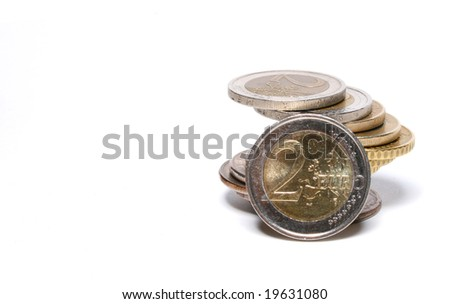 Coins of Euro in stack with 2 Euro in front - stock photo