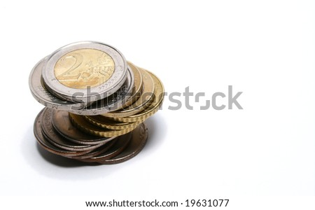 Coins of Euro in stack with 2 Euro on top - stock photo