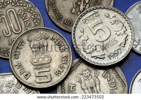 Coins of India. The Sarnath Lion Capital of Ashoka served as the state emblem of India depicted in the Indian five rupees coin.  - stock photo