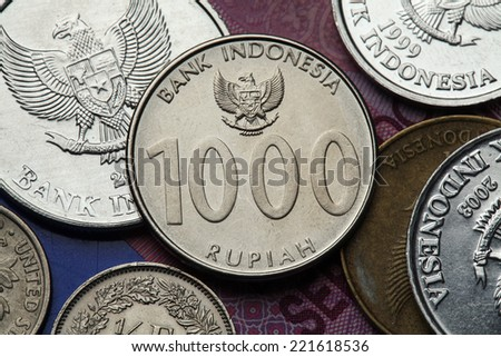 Coins of Indonesia. Indonesian national emblem called the Garuda Pancasila depicted in the Indonesian one thousand rupiah coin. - stock photo