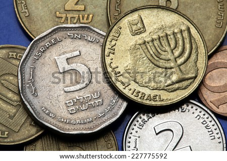 Coins of Israel. Menorah depicted in the Israeli ten agorot coin and the Israeli five agorot coin. - stock photo