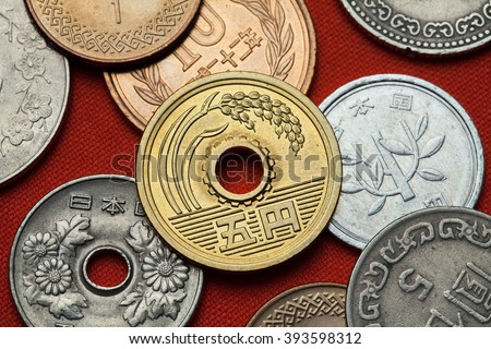 Coins of Japan. Ear of rice depicted in the Japanese five yen coin. - stock photo