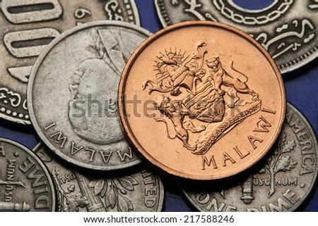 Coins of Malawi. Malawian coat of arms and Malawian national hero John Chilembwe depicted in Malawian tambala coins.   - stock photo
