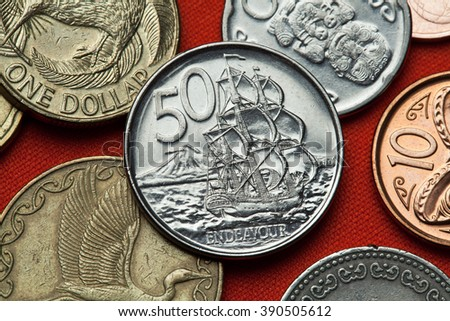 Coins of New Zealand. HM Bark Endeavour and Mount Taranaki depicted in the New Zealand 50 cents coin. - stock photo