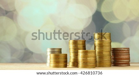 Coins of Saving money concept with bokeh background
