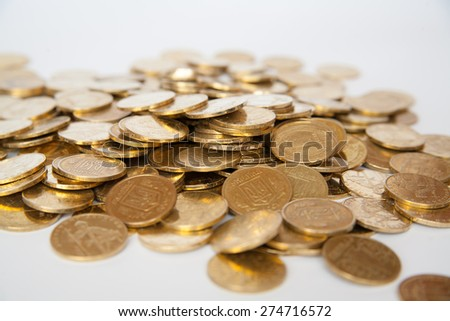 coins of Ukrainian hryvnias on white background