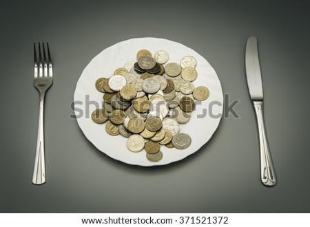 Coins on a plate - stock photo