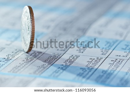 Coins on stock index background - stock photo