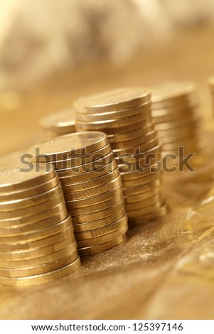 coins on the gold background - stock photo