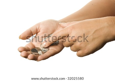 Coins on the palm on a white background.