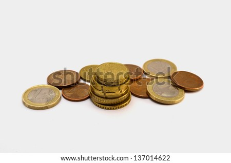 coins on white background stacked pyramid