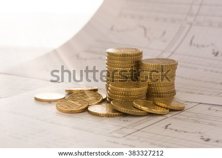 Coins placed on the report of financial graph. financial background, investment concept, finances concept. - stock photo