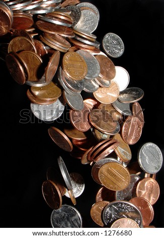 coins pouring like a waterfall, frozen in space - stock photo